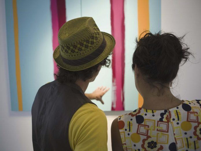 A man and woman looking at Contemporary art at the Rymer Gallery in Nashville