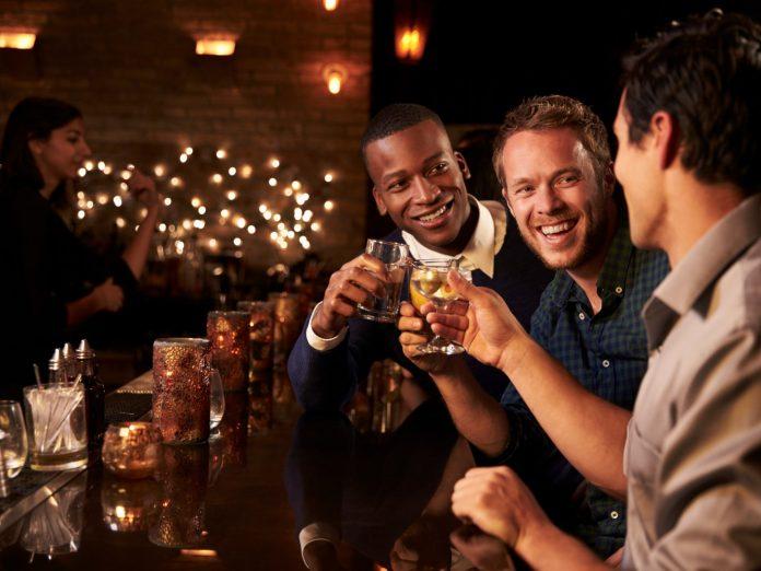 Three men having a good time at the bar; gay-friendly Nashville
