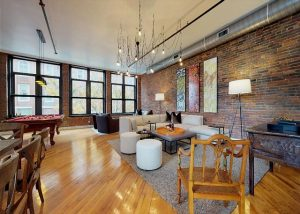 living room with chandelier, brick wall, furniture
