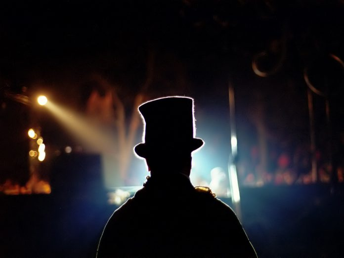 magician silhouette performing