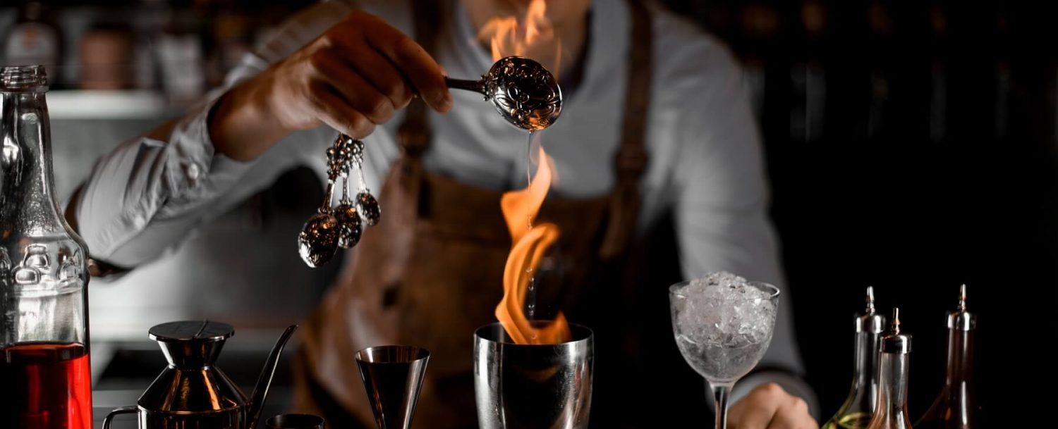 bartender making drink with fire