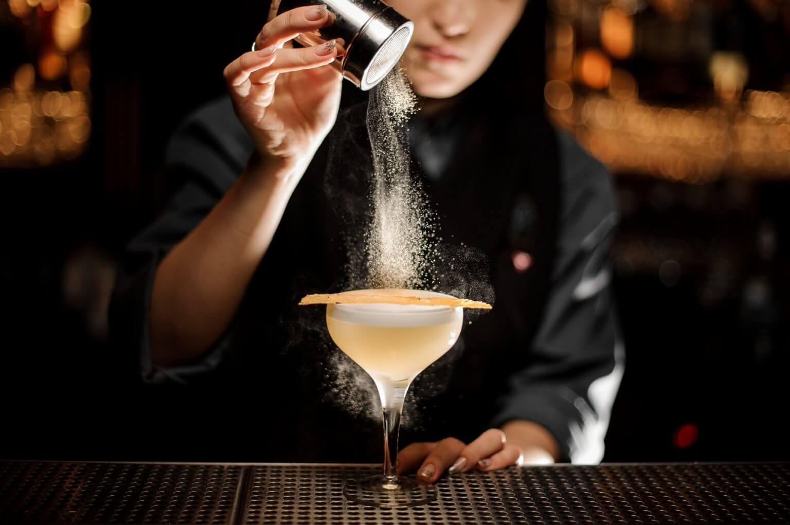 craft cocktail being made at bar bartender